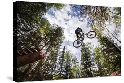 Mike Montgomery Jumping His Downhill Mountain Bike At Canyons Resort-Louis Arevalo-Stretched Canvas Print