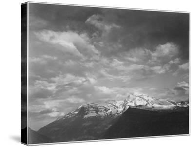 "Dark Foreground And Clouds Mountains Highlighted ""Heaven's Peak"" Glacier NP Montana. 1933-1942-Ansel Adams-Stretched Canvas Print"