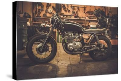 Vintage Style Cafe-Racer Motorcycle in Customs Garage-NejroN Photo-Stretched Canvas Print
