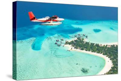 Sea Plane Flying above Maldives Islands-Jag_cz-Stretched Canvas Print