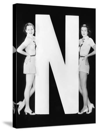 Two Women with Huge Letter N-Everett Collection-Stretched Canvas Print