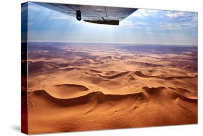 Beautiful Landscape of the Namib Desert under the Wing of the Aircraft at Sunset. Flying on a Plane-Oleg Znamenskiy-Stretched Canvas Print
