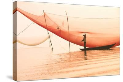 Unidentified Fisherman Checks His Nets in Early Morning on River in Hoian, Vietnam-Jimmy Tran-Stretched Canvas Print
