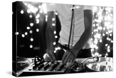 A Cool Male Dj on the Turntables-dubassy-Stretched Canvas Print