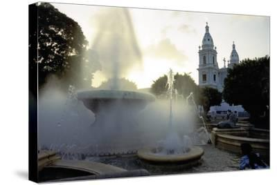 Fountains And The Ponce Cathedral-George Oze-Stretched Canvas Print