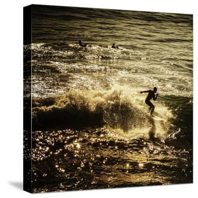 A Male Surfer Rides A Wave In The Pacific Ocean Off The Coast Of Santa Cruz This Image Tinted-Ron Koeberer-Stretched Canvas Print
