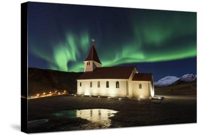 A Traditional Icelandic Church Is Framed By The Stunning Aurora Borealis-Joe Azure-Stretched Canvas Print