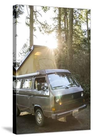 A Dog Peaks His Head Out In The Morning From A Volkswagen Bus On The Washington Coast-Hannah Dewey-Stretched Canvas Print