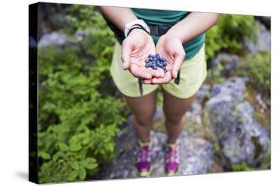 Woman Holds Out Wild Huckleberries She Picked While Hiking-Hannah Dewey-Stretched Canvas Print