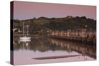 Puente de la Maza bridge at dusk, San Vicente de la Barquera, Cantabria Province, Spain--Stretched Canvas Print