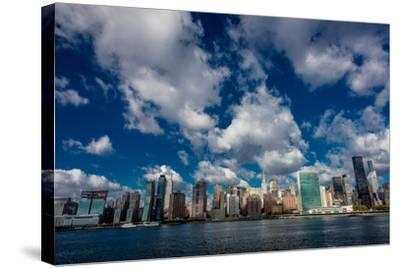 Skyline of Midtown Manhattan seen from the East River showing the Chrysler Building and the Unit...--Stretched Canvas Print