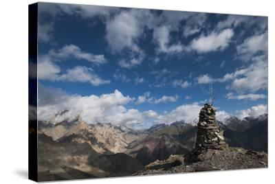 A cairn on top of the Dung Dung La in Ladakh, a remote Himalayan region in north India, Asia-Alex Treadway-Stretched Canvas Print