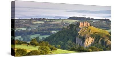 Carreg Cennen Castle at dawn on a misty summer morning, Brecon Beacons National Park, Carmarthenshi-Adam Burton-Stretched Canvas Print