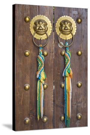 Door of guesthouse, Lijiang (UNESCO World Heritage Site), Yunnan, China-Ian Trower-Stretched Canvas Print