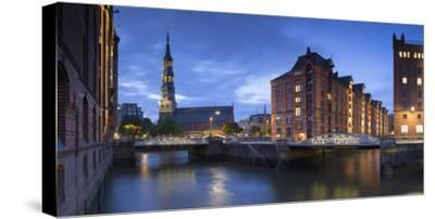 St Katharinen Church and warehouses of Speicherstadt (UNESCO World Heritage Site), Hamburg, Germany-Ian Trower-Stretched Canvas Print