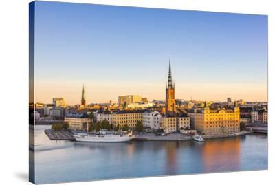 Stockholm, Sweden, Northern Europe. High angle view over Riddarholmen and Riddarholmskyrkan (church-Marco Bottigelli-Stretched Canvas Print