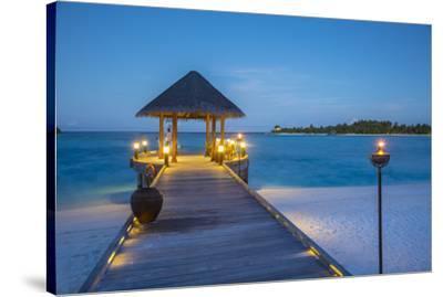 Jetty on the Anantara Dhigu resort, South Male Atoll, Maldives-Jon Arnold-Stretched Canvas Print