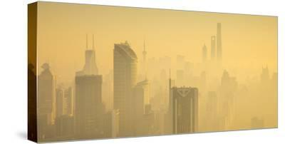 Skyline of Shanghai from Jing'An on a foggy November morning, China-Jon Arnold-Stretched Canvas Print