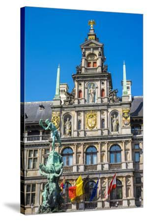 Belgium, Flanders, Antwerp (Antwerpen). Stadhuis city hall and statue of Silvius Brabo on Grote Mar-Jason Langley-Stretched Canvas Print
