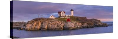 USA, Maine, York Beach, Nubble Light Lighthouse with Christmas decorations, dusk-Walter Bibikw-Stretched Canvas Print