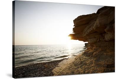 Sundown on the stone beach island Kos, Greece,-Rasmus Kaessmann-Stretched Canvas Print