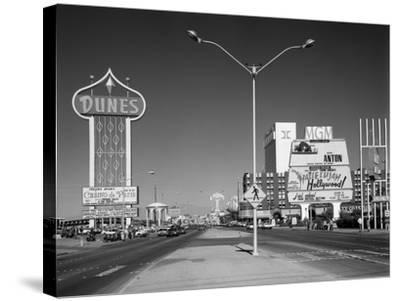 1980s Daytime the Strip with Signs for the Dunes Mgm Flamingo Las Vegas, Nevada--Stretched Canvas Print
