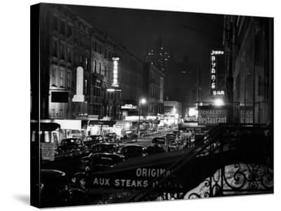1940s Night Street Scene West 52nd Street Lights from Numerous Clubs and Nightclubs New York--Stretched Canvas Print