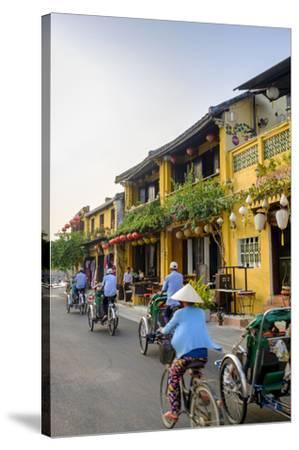General view of shop houses and bicycles in Hoi An, Vietnam, Indochina, Southeast Asia, Asia-Alex Robinson-Stretched Canvas Print