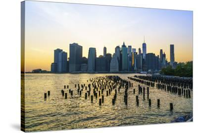 Lower Manhattan skyline across the East River at sunset, New York City, New York, United States of -Fraser Hall-Stretched Canvas Print