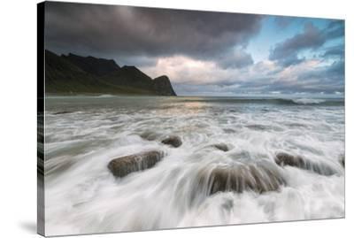 Lights of midnight sun lights up the waves of the blue sea, Unstad, Vestvagoy, Lofoten Islands, Nor-Roberto Moiola-Stretched Canvas Print