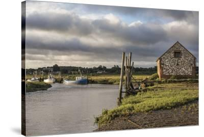 A view of boats moored in the creek at Thornham, Norfolk, England, United Kingdom, Europe-Jon Gibbs-Stretched Canvas Print