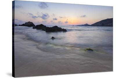 The last lights of the sunset are reflected on sea waves and sandy beach, Licata, Province of Agrig-Roberto Moiola-Stretched Canvas Print