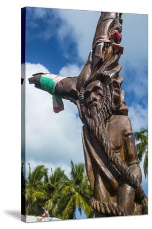 Wooden carvings on the Monument des Dix-Neuf (Monument of 19), Ouvea, Loyalty Islands, New Caledoni-Michael Runkel-Stretched Canvas Print