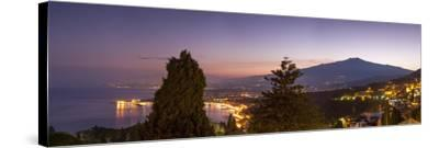 Panoramic view of Mount Etna and Giardini Naxos at dusk from Taormina, Sicily, Italy, Mediterranean-John Miller-Stretched Canvas Print
