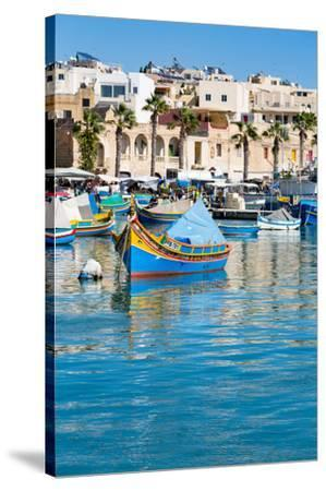 Traditional brightly painted fishing boats in the harbour at Marsaxlokk, Malta, Mediterranean, Euro-Martin Child-Stretched Canvas Print