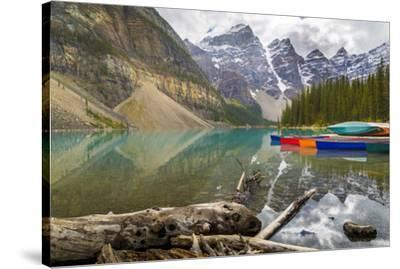 Tranquil setting of rowing boats on Moraine Lake, Banff National Park, UNESCO World Heritage Site, -Frank Fell-Stretched Canvas Print