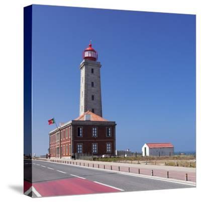 Farol Penedo da Saudade lighthouse, Sao Pedro de Moel, Atlantic Ocean, Portugal, Europe-Markus Lange-Stretched Canvas Print