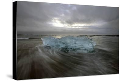 Black Sand Beach with Ice and Small Icebergs-Raul Touzon-Stretched Canvas Print
