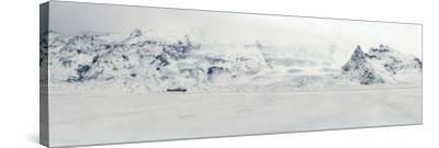 Panorama Image of Mountain Range and Glacier Toungues Covered in Snow-Raul Touzon-Stretched Canvas Print