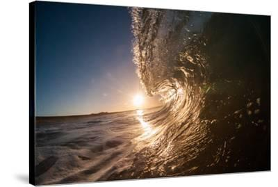 Water shot of a tubing wave off a Hawaiian beach-Mark A Johnson-Stretched Canvas Print