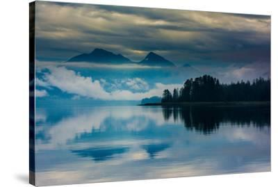 The misty mountains and calm waters of the Tongass National Forest, Southeast Alaska, USA-Mark A Johnson-Stretched Canvas Print