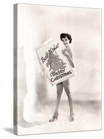 Naked Woman Covered by a Giant Christmas Card--Stretched Canvas Print