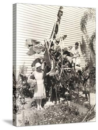 Three Women Decorating Banana Tree for Christmas--Stretched Canvas Print
