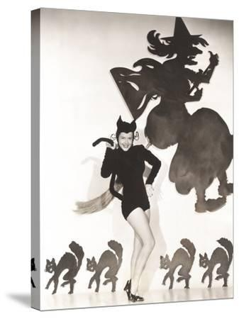 Woman in Cat Costume Posing Against Halloween Themed Wall--Stretched Canvas Print