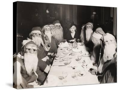Woman Lunching with Twelve Santa Clauses--Stretched Canvas Print