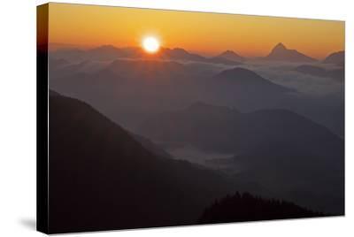 Germany, Bavaria, Bavarian Alpine Foothills, Jochberg, Sunrise Above the Mangfallgebirge, Halserspi-Bernd Rommelt-Stretched Canvas Print