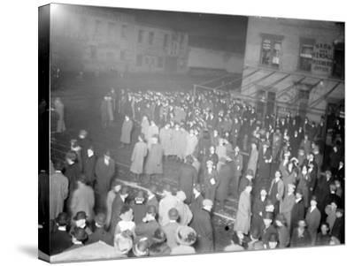 Crowd awaiting survivors from the Titanic, 1912--Stretched Canvas Print