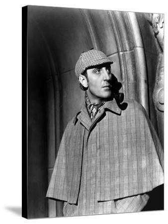 THE HOUND OF THE BASKERVILLES, 1939 directed by SIDNEY LANFIELD. Basil Rathbone (b/w photo)--Stretched Canvas Print