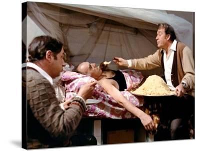LA GRANDE BOUFFE, 1973 directed by MARCO FERRERI Philippe Noiret, Michel Piccoli and Ugo Tognazzi (--Stretched Canvas Print