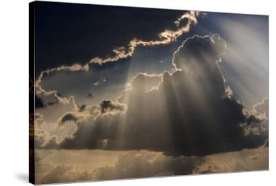 Sun rays and clouds, Togo, Africa-Art Wolfe-Stretched Canvas Print